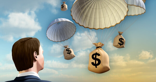 Concept of cryptocurrencies being airdropped from parachute
