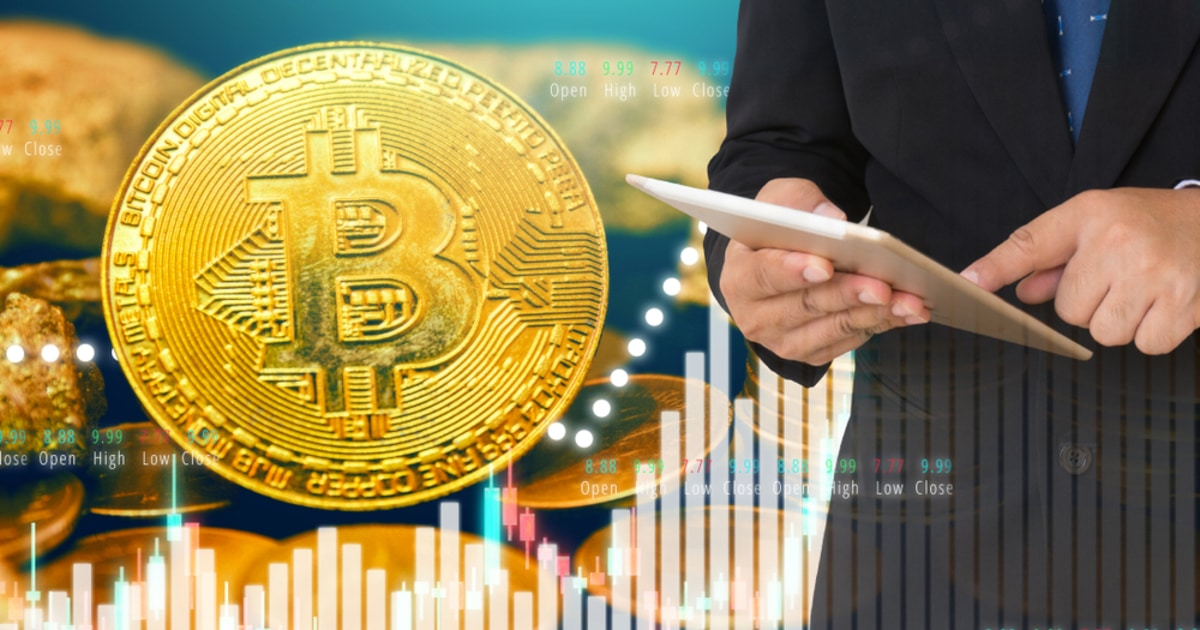 businessman investing in crypto like Bitcoin on stock market background