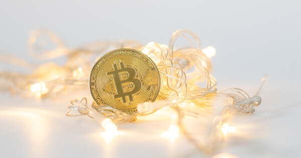 Bitcoin surrounded by decorating lights