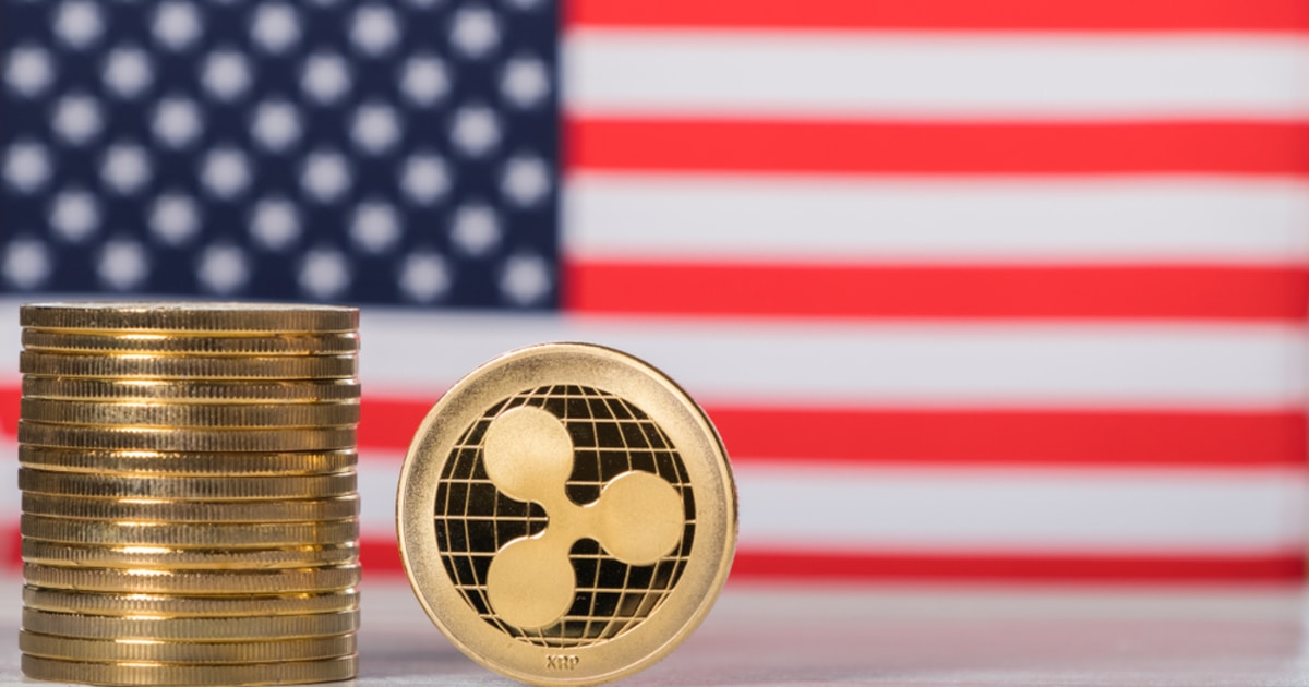 Ripple XRP coins with a US flag as a background