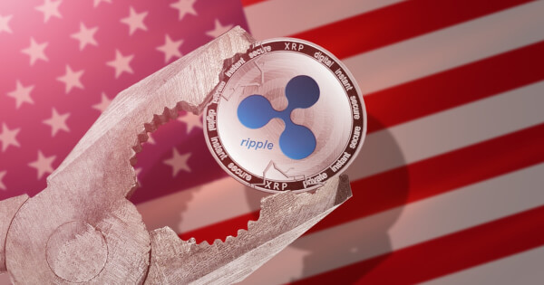 Ripple cryptocurrency faced with pressure on US flag background